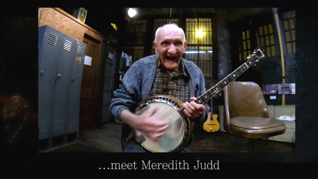Our everyday hero Meredith, playing banjo music to create a feel good story.