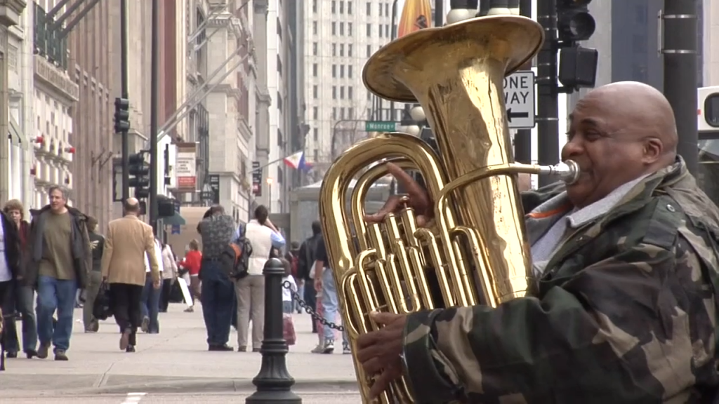 Tuba player Aaron showing good vibe on the streets of Chicago.