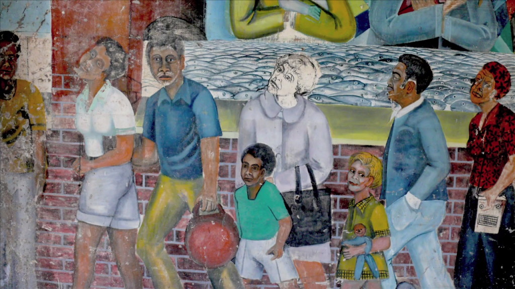 More mural art depicting a family walking on the neighborhood streets.