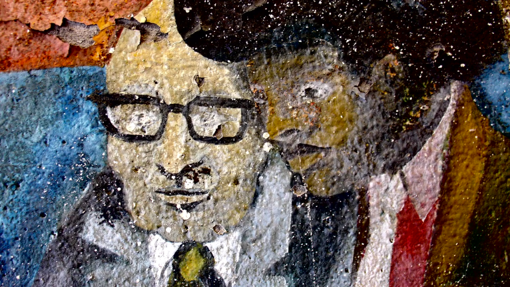 Another example of Mural art painting of two men collaborating.